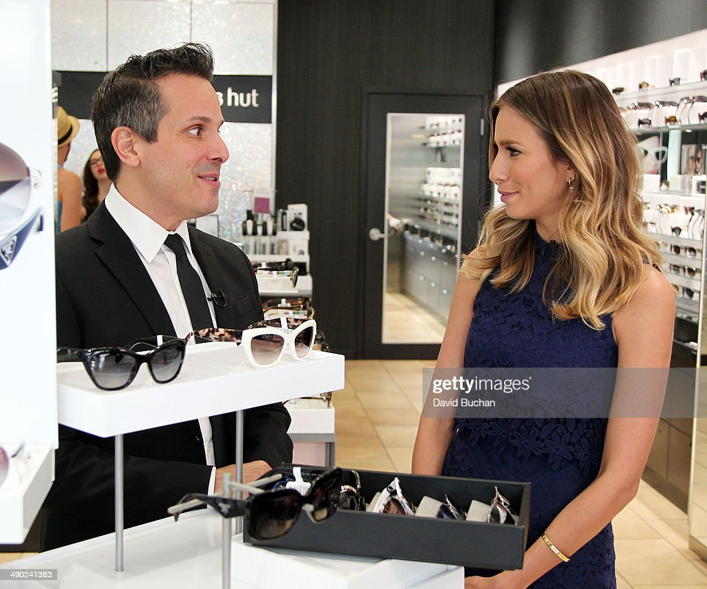David Hanson from Sunglass Hut with host Renee Bargh as EXTRA shows off the latest Spring/Summer Sunglass trends at Westfield Century City on May 13, 2014 in Los Angeles, California.