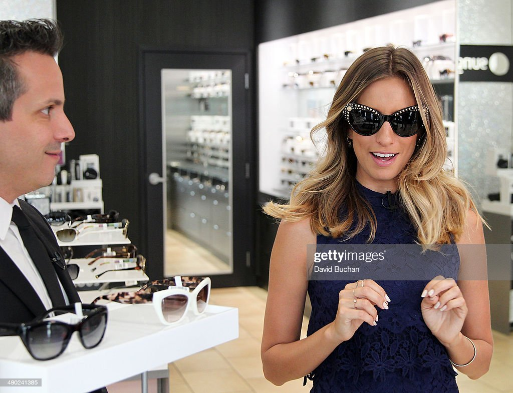 David Hanson from Sunglass Hut with host <a gi-track='captionPersonalityLinkClicked' href=/galleries/search?phrase=Renee+Bargh&family=editorial&specificpeople=4267341 ng-click='$event.stopPropagation()'>Renee Bargh</a> as EXTRA shows off the latest Spring/Summer Sunglass trends at Westfield Century City on May 13, 2014 in Los Angeles, California.
