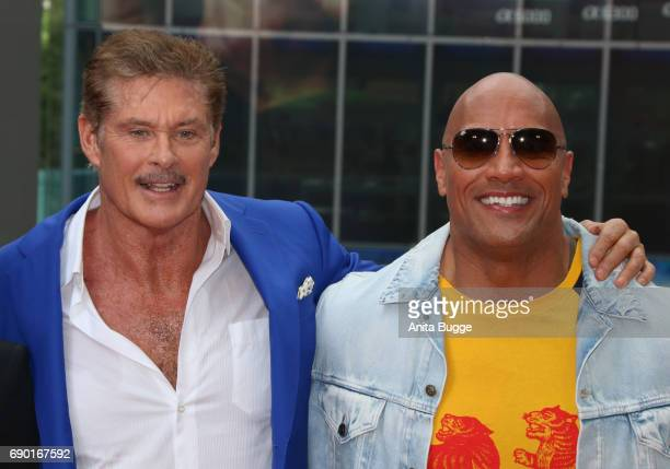 David Hasselhoff and actor Dwayne Johnson attends the 'Baywatch' photocall in Berlin on May 30 2017 in Berlin Germany