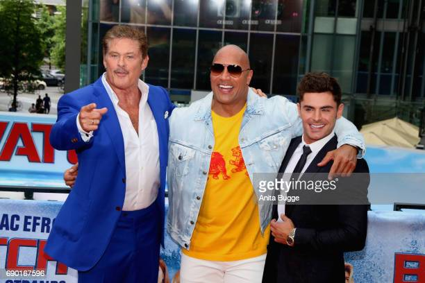 David Hasselhoff and actors Dwayne Johnson and Zac Efron attend the 'Baywatch' photocall in Berlin on May 30 2017 in Berlin Germany