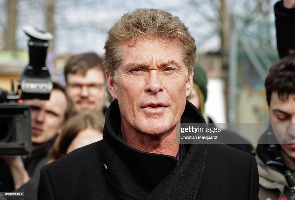 <a gi-track='captionPersonalityLinkClicked' href=/galleries/search?phrase=David+Hasselhoff&family=editorial&specificpeople=209380 ng-click='$event.stopPropagation()'>David Hasselhoff</a> attends a Save the Wall protest at the East Side Gallery on March 17, 2013 in Berlin, Germany. A real estate developer is planning to build a 14-storey apartment building between the East Side Gallery and the Spree River and needs to remove the Wall section in order to allow access to the construction site.on March 17, 2013 in Berlin, Germany.