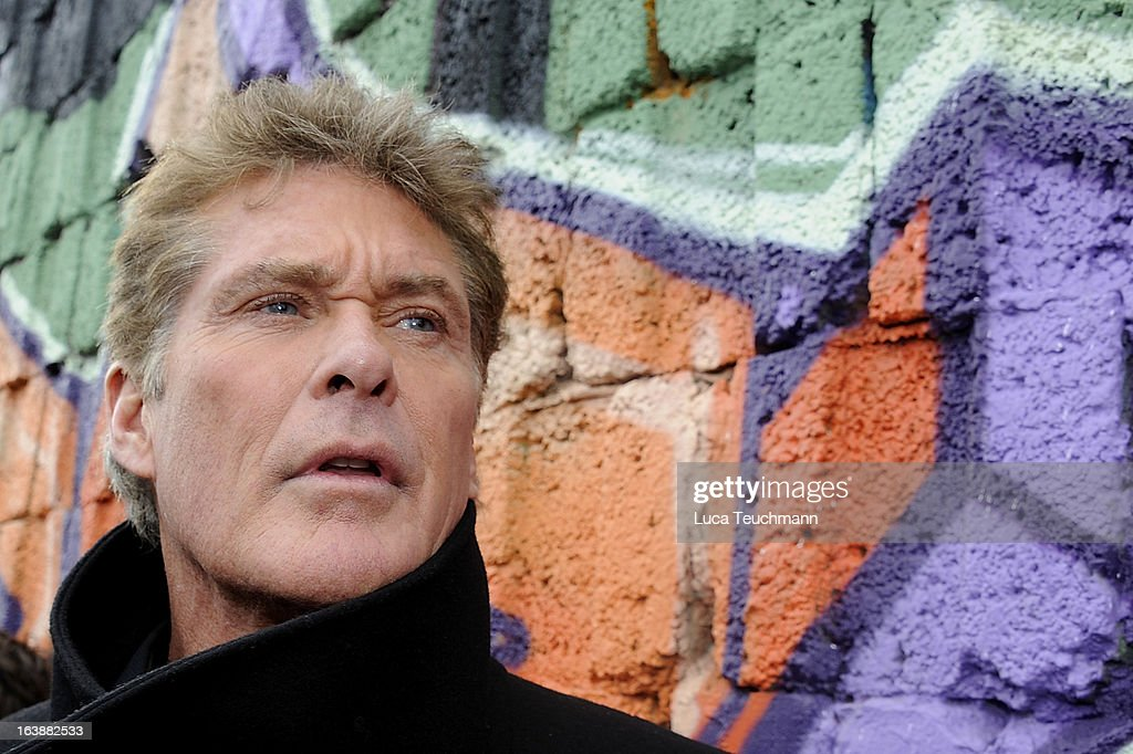 <a gi-track='captionPersonalityLinkClicked' href=/galleries/search?phrase=David+Hasselhoff&family=editorial&specificpeople=209380 ng-click='$event.stopPropagation()'>David Hasselhoff</a> attends 'Save the Wall' Protest at East Side Gallery on March 17, 2013 in Berlin, Germany. A real estate developer is planning to build a 14-storey apartment building between the East Side Gallery and the Spree River and needs to remove the Wall section in order to allow access to the construction site. Protesters managed to temporarily halt the dismantling of the section on March 1. Critics, including East Side Gallery mural artists and Spree River embankment development opponents, decry the move, citing the importance of the East Side Gallery's status as a protected landmark and a major tourist attraction. The East Side Gallery is approximately 1.3 kilometers long.