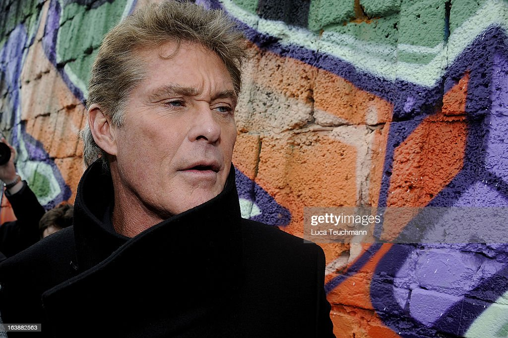 David Hasselhoff attends 'Save the Wall' Protest at East Side Gallery on March 17, 2013 in Berlin, Germany. A real estate developer is planning to build a 14-storey apartment building between the East Side Gallery and the Spree River and needs to remove the Wall section in order to allow access to the construction site. Protesters managed to temporarily halt the dismantling of the section on March 1. Critics, including East Side Gallery mural artists and Spree River embankment development opponents, decry the move, citing the importance of the East Side Gallery's status as a protected landmark and a major tourist attraction. The East Side Gallery is approximately 1.3 kilometers long.