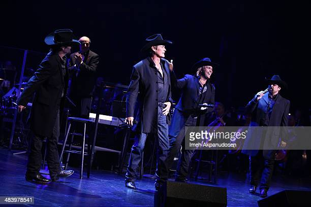 David Hasselhoff performs with singers JC Fisher Marcus Collins and John Hagen of The Texas Tenors during the Desert Symphony's 25th Anniversary...
