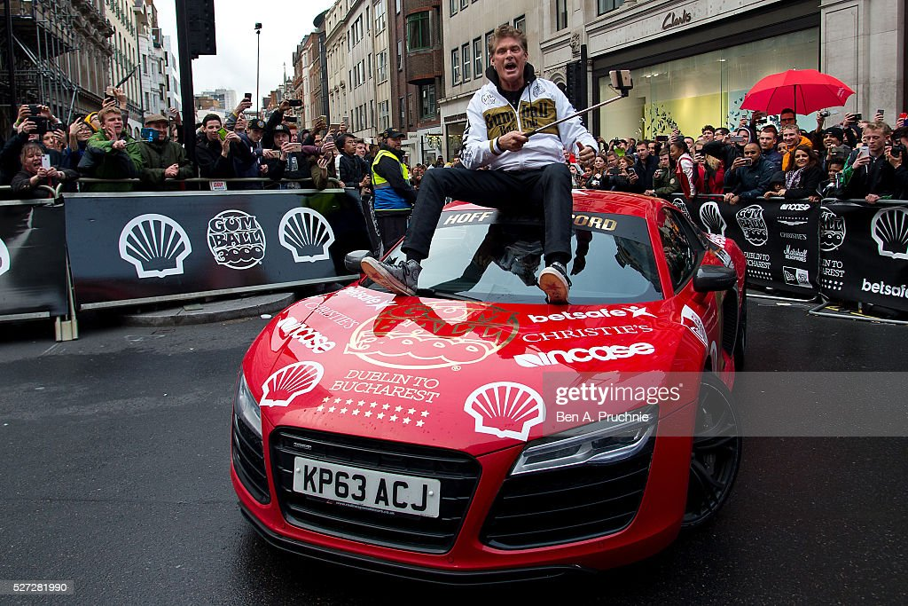 David Hasselhoff rides on the bonnet of his Audi R8 as Gumball Rally closes down Regent Street at Regent Street on May 3, 2016 in London, England.