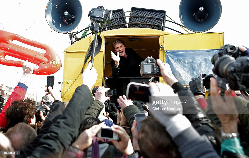 David Hasselhoff speaks to the crowd at a Save the Wall protest at the East Side Gallery on March 17, 2013 in Berlin, Germany. A real estate developer is planning to build a 14-storey apartment building between the East Side Gallery and the Spree River and needs to remove the Wall section in order to allow access to the construction site.