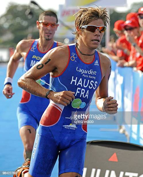 David Hauss of France leads compatriot Tony Moulai as they contest the men's run section at the Sydney round of the ITU World Championship Triathlon...