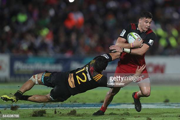 David Havili of the Crusaders is tackled by Anton Lienert Brown of the Chiefs during the round 15 Super Rugby match between the Chiefs and the...