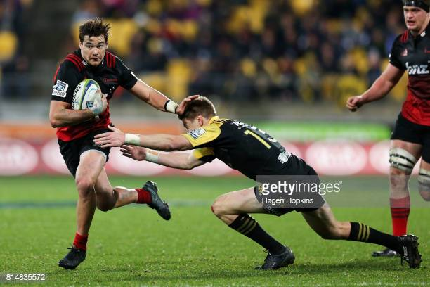 David Havili of the Crusaders is tackled by Jordie Barrett of the Hurricanes during the round 17 Super Rugby match between the Hurricanes and the...