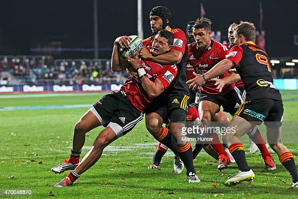 David Havili of the Crusaders is tackled by Liam Messam of the Chiefs during the round 10 Super Rugby match between the Crusaders and the Chiefs at...