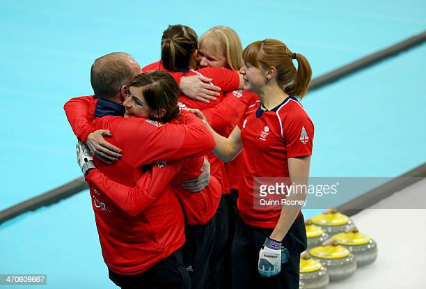 David Hay coach of Great Britain Eve Muirhead Vicki Adams Rhona Howie team official of Great Britain and Claire Hamilton celebrate as they win the...