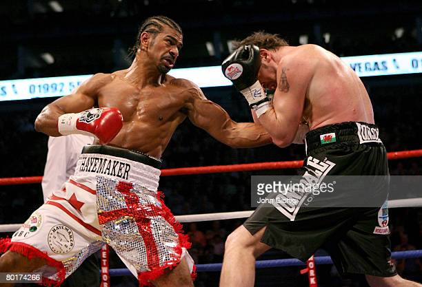 David Haye exchanges punches with Enzo Maccarinelli during the Unified World Cruiserweight title at the O2 Arena March 9 2008 in London England Haye...