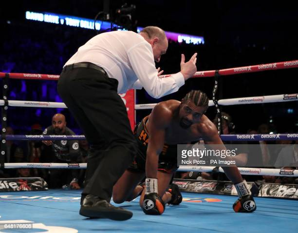 David Haye is counted down by referee Phil Edwards after being knocked down by Tony Bellew during the heavyweight contest at The O2 PRESS ASSOCIATION...