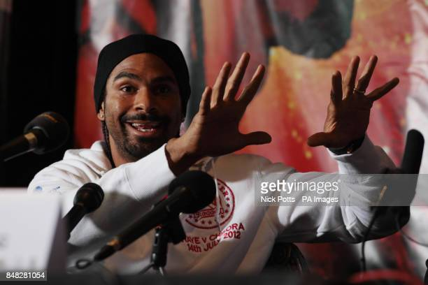 David Haye mocks Dereck Chisora during the Head to Head at the Gilgamesh Restaurant Bar and Lounge London