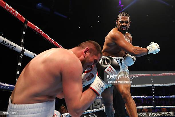 David Haye of England knocks down Arnold Gjergjaj of Switzerland during their Heavyweight fight at The O2 Arena on May 21 2016 in London England