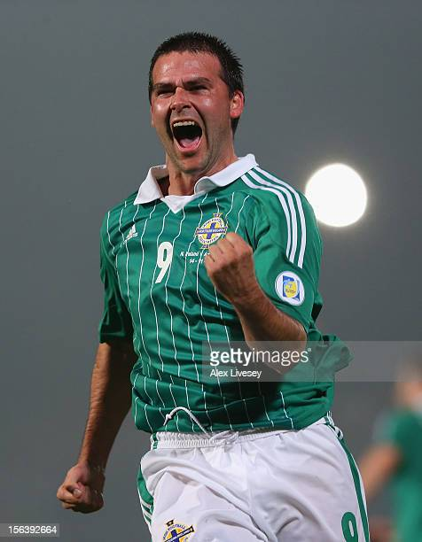 David Healy of Northern Ireland celebrates after scoring a late equalizing goal during the FIFA 2014 World Cup Group F Qualifying match between...