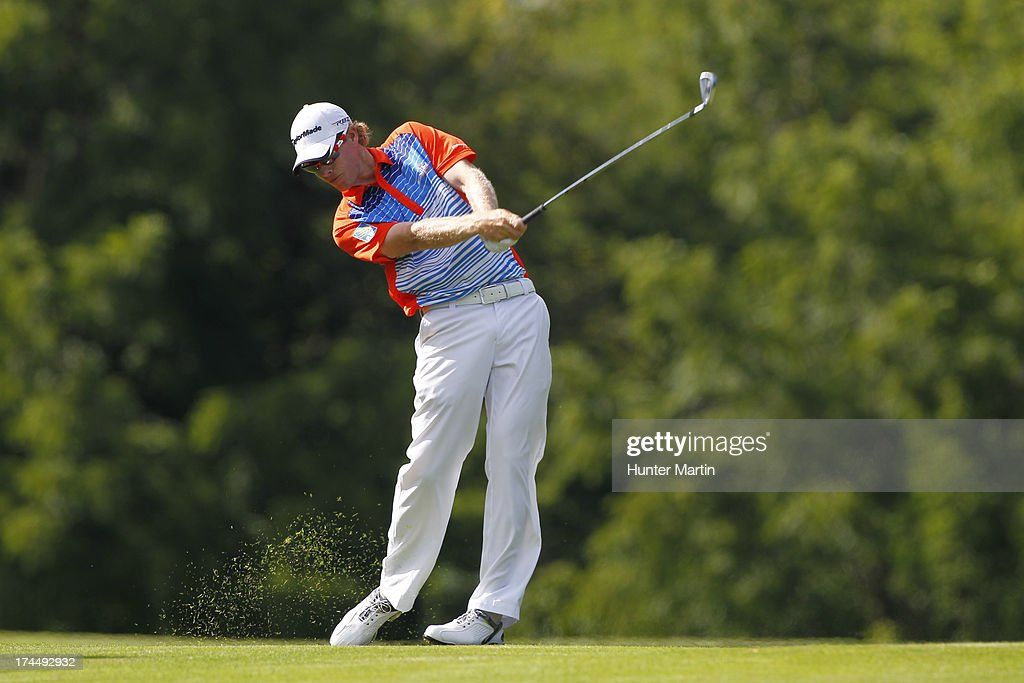 David Hearn hits his second shot on the 16th hole during round two of the RBC Canadian Open at Glen Abby Golf Club on July 26, 2013 in Oakville, Ontario, Canada.