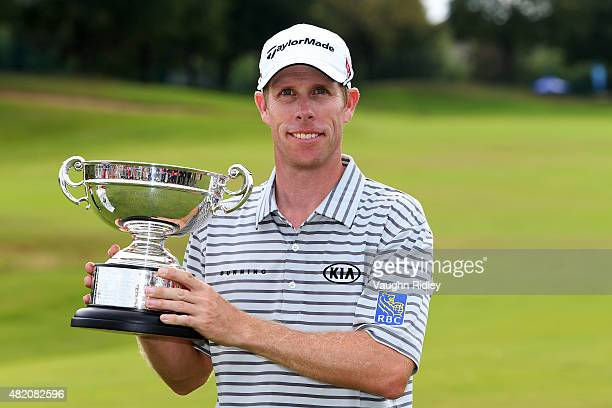 David Hearn of Canada celebrates with the best Canadian trophy after finishing third in the final round of the RBC Canadian Open at Glen Abbey Golf...