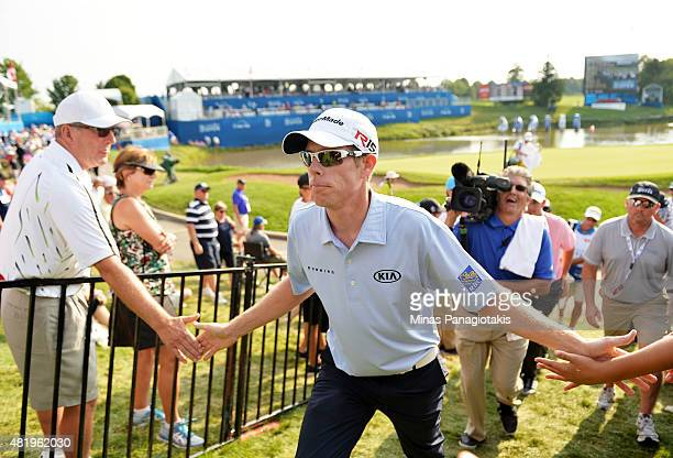 David Hearn of Canada greets fans after finishing round three of the RBC Canadian Open at Glen Abbey Golf Club on July 25 2015 in Oakville Canada