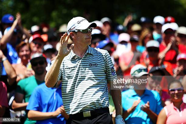 David Hearn of Canada greets fans on the first tee during the final round of the RBC Canadian Open at Glen Abbey Golf Club on July 26 2015 in...