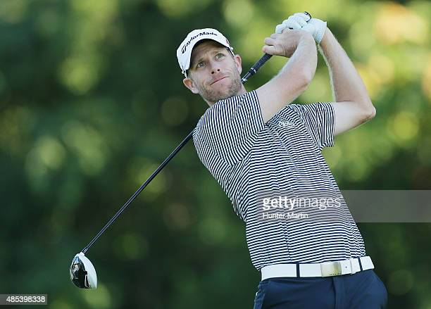 David Hearn of Canada hits his tee shot on the 12th hole during the first round of The Barclays at Plainfield Country Club on August 27 2015 in...