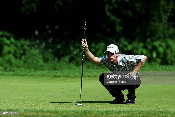 David Hearn of Canada lines up a putt during the final round of the RBC Canadian Open at Glen Abbey Golf Club on July 26 2015 in Oakville Canada