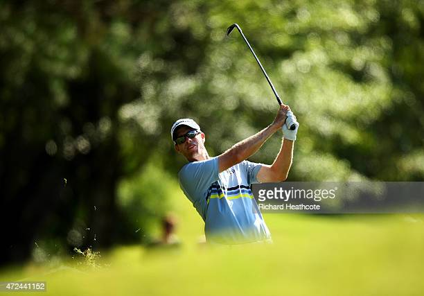 David Hearn of Canada plays his second shot on the 11th hole during round one of THE PLAYERS Championship at the TPC Sawgrass Stadium course on May 7...