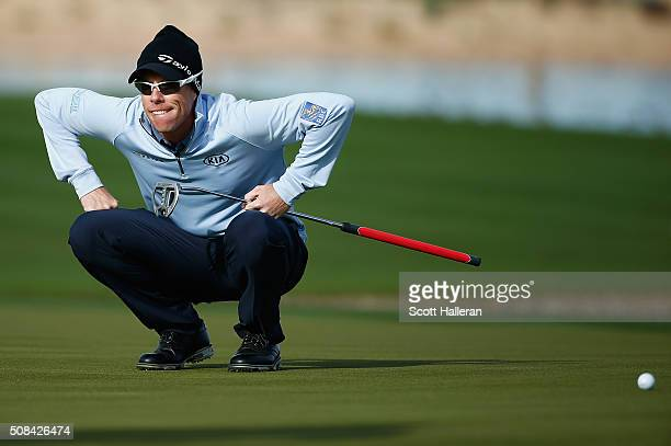David Hearn of Canada prepares to putt on the 15th hole during the first round of the Waste Management Phoenix Open at TPC Scottsdale on February 4...