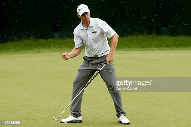David Hearn of Canada reacts after making a birdie putt on the 18th hole during a playoff against Danny Lee of New Zealand Robert Streb and Kevin...