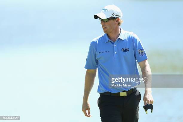 David Hearn of Canada reacts on the 17th green during the third round of the Travelers Championship at TPC River Highlands on June 24 2017 in...