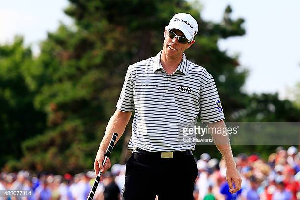 David Hearn of Canada reacts to a missed putt on the 18th green during the final round of the RBC Canadian Open at Glen Abbey Golf Club on July 26...