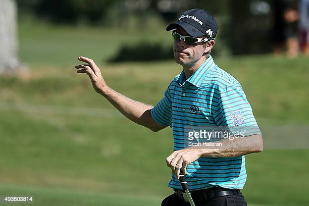 David Hearn of Canada waves after putting for birdie on the ninth green during the first round of the Shriners Hospitals For Children Open on October...