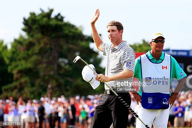 David Hearn of Canada waves to fans after finishing on the 18th green during the final round of the RBC Canadian Open at Glen Abbey Golf Club on July...