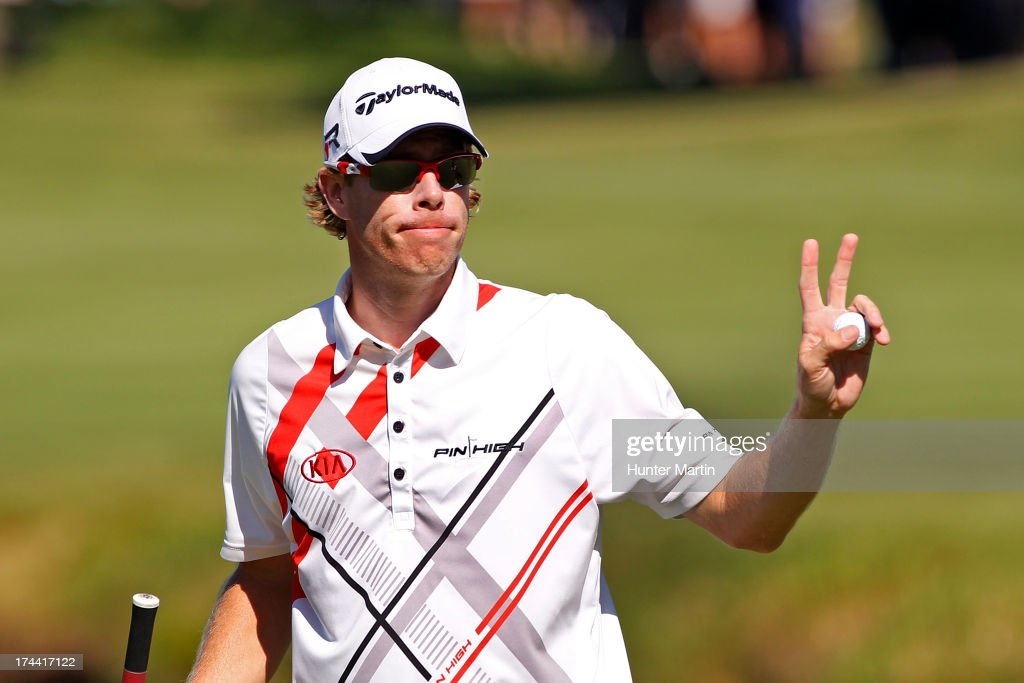 David Hearn waves to the crowd after putting out on the 18th hole during round one of the RBC Canadian Open at Glen Abby Golf Club on July 25, 2013 in Oakville, Ontario, Canada.