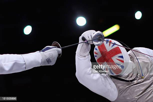 David Heaton of Great Britain competes against Gyula Mato of Hungary in the Men's Team Catagory Open Wheelchair Fencing on day 10 of the London 2012...