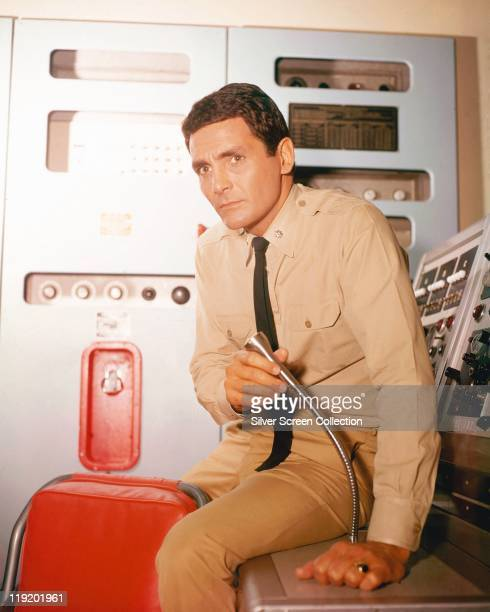 David Hedison US actor in costume as he holds a gooseneck microphone in a publicity portrait issued for the US television series ''Voyage to the...