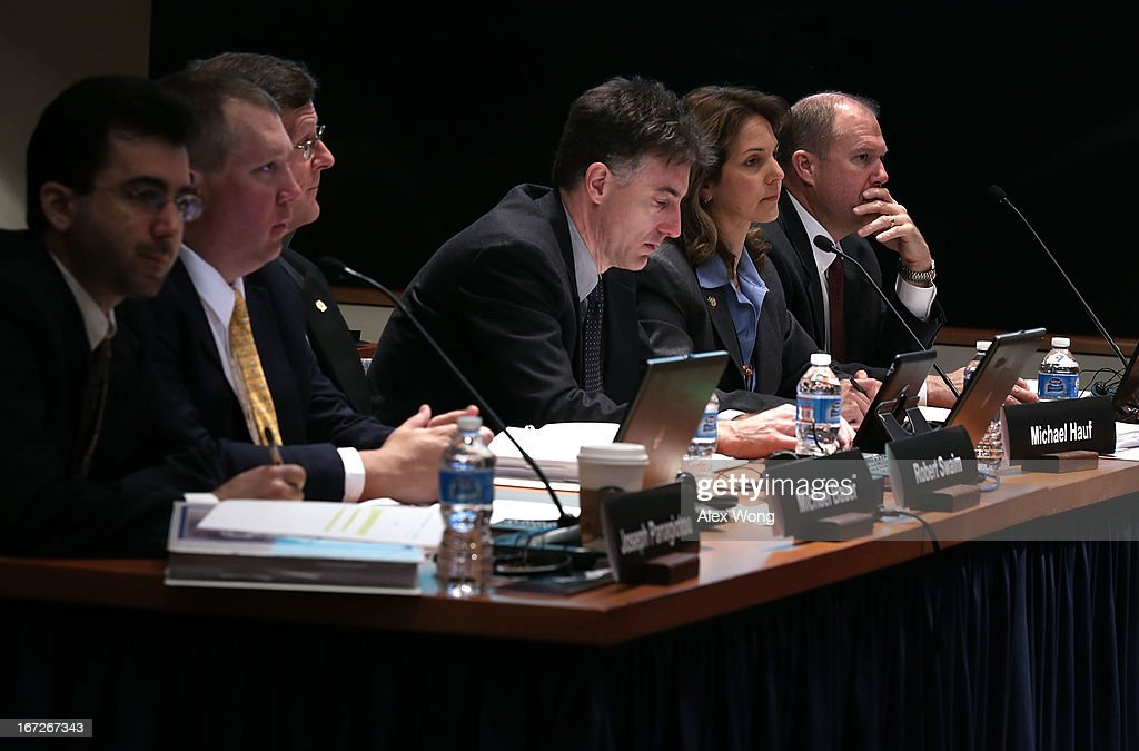 David Helson, Dana Schulze, Michael Hauf, Robert Swaim, Michael Bauer, and Joseph Panagiotou listen during an investigative hearing into the Boeing 787 battery fire before the National Transportation Safety Board April 23, 2013 in Washington, DC. The NTSB held a two-day hearing to investigate the design, testing, certification and operation of the lithium-ion battery on the Boeing 787 and the battery fire incident.