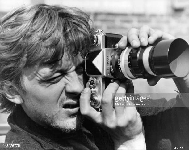 David Hemmings bearded and ragged from his stay in a down and out hostel where he has been taking pictures of his book in a scene from the film 'Blow...