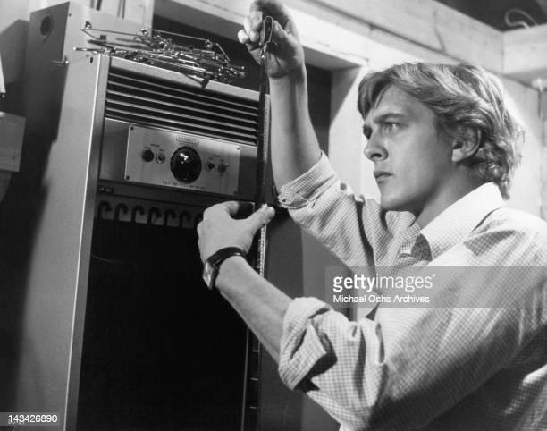David Hemmings develops film in his dark room in a scene from the film 'Blow Up' 1966