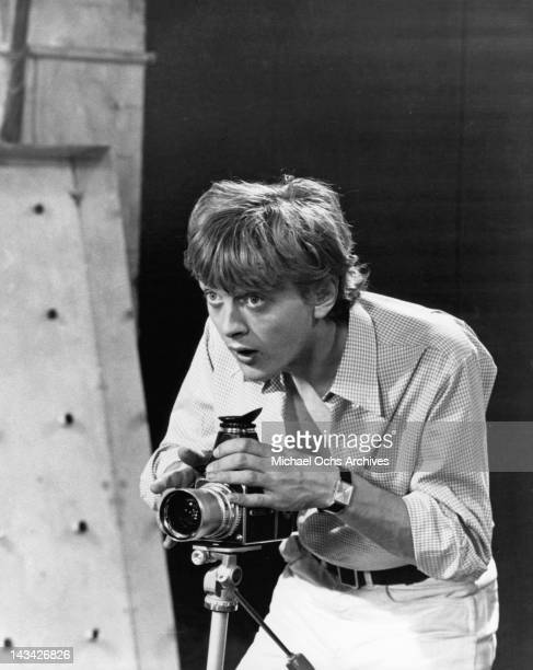 David Hemmings photographer is excited by a photographic subject in a scene from the film 'Blow Up' 1966
