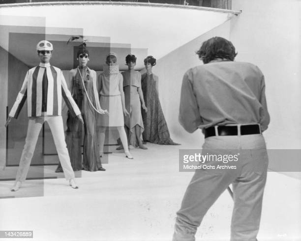 David Hemmings shoots a high fashion session with five models Jill Kennington Peggy Moffit Rosaleen Murray Ann Norman and Melanie Hampshire in a...