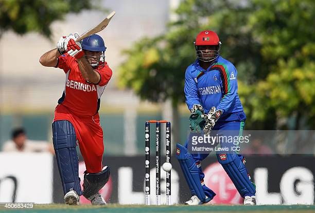 David Hemp of Bermuda hits the ball towards the boundary as Mohammad Shahzad of Afghanistan looks on during the ICC World Twenty20 Qualifier match...