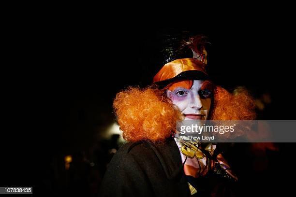 David Henderson dressed as the Mad Hatter from Alice in Wonderland poses before the start of the Allendale Tar Barrel festival on December 31 2010 in...
