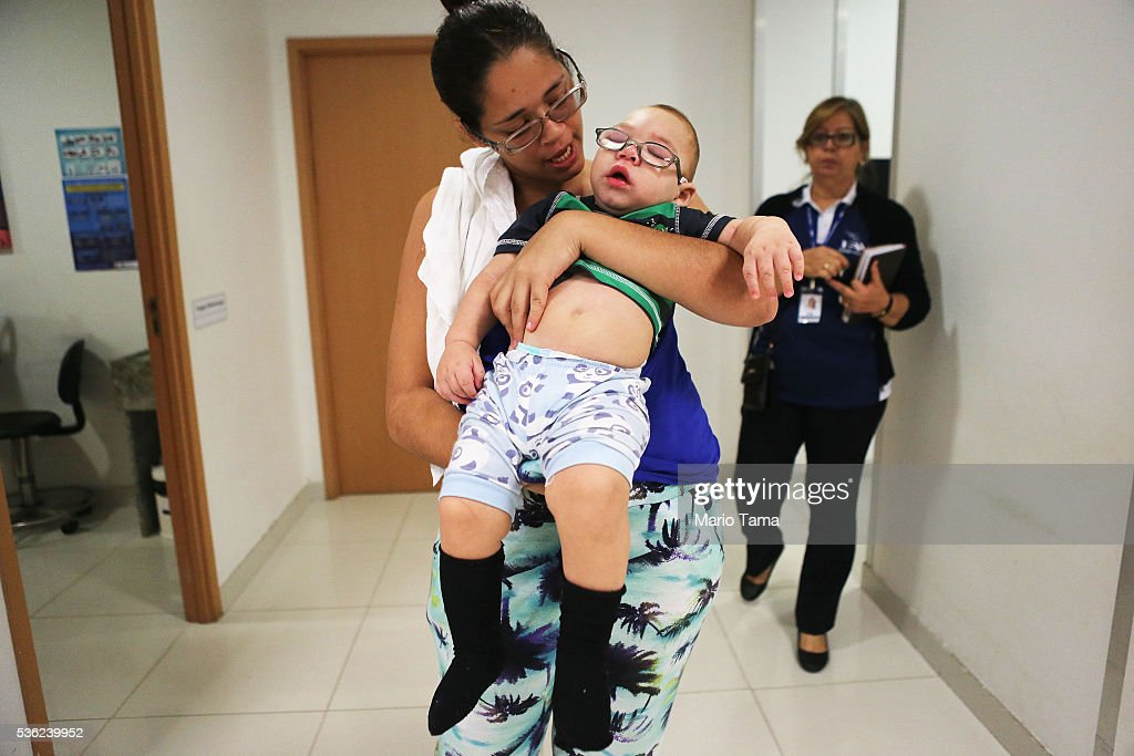 David Henrique Ferreira, 9-months-old, who was born with microcephaly, is carried by his mother Mylene after receiving a pair of glasses at a clinic on May 31, 2016 in Recife, Brazil. Microcephaly is a birth defect linked to the Zika virus where infants are born with abnormally small heads. Vision problems have been reported in some of the infants as well. The city of Recife and surrounding Pernambuco state remain the epicenter of the Zika virus outbreak, which has now spread to many countries in the Americas. A group of health experts recently called for the Rio 2016 Olympic Games to be postponed or cancelled due to the Zika threat but the WHO (World Health Organization) rejected the proposal. The Olympic torch passed through Recife today.
