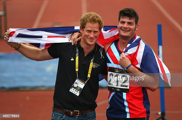 David Henson of Great Britain celebrates with Prince Harry after winning the gold medal in the 200m Men Ambulant IT2 final during day 1 of the...