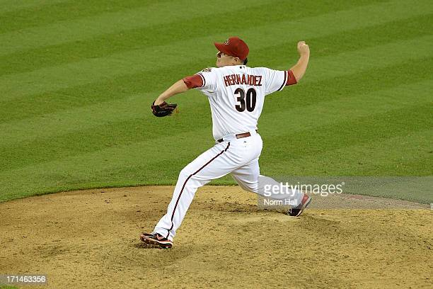 David Hernandez of the Arizona Diamondbacks delivers a pitch against the Miami Marlins at Chase Field on June 18 2013 in Phoenix Arizona