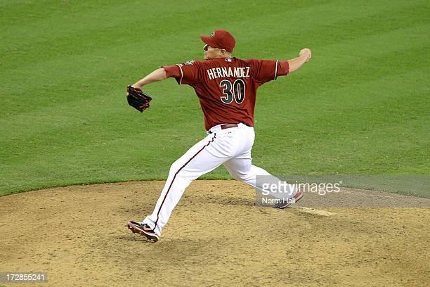 David Hernandez of the Arizona Diamondbacks delivers a pitch against the Cincinnati Reds at Chase Field on June 23 2013 in Phoenix Arizona