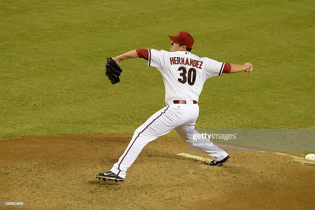 David Hernandez #30 of the Arizona Diamondbacks delivers a pitch against the Los Angeles Dodgers at Chase Field on September 16, 2013 in Phoenix, Arizona.