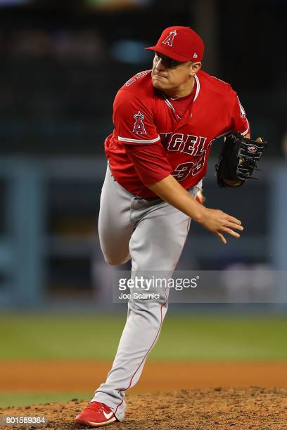 David Hernandez of the Los Angeles Angels makes a pitch in the 8th inning against the Los Angeles Dodgers at Dodger Stadium on June 26 2017 in Los...