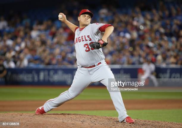 David Hernandez of the Los Angeles Angels of Anaheim delivers a pitch in the eighth inning during MLB game action against the Toronto Blue Jays at...